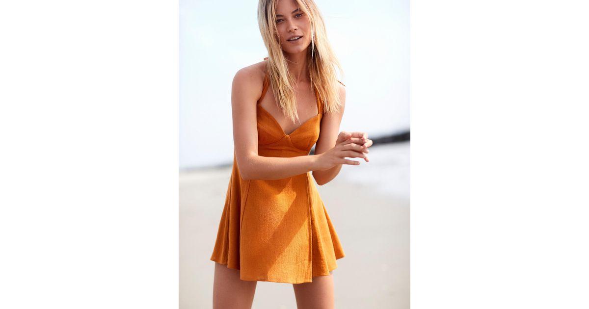 2798addae85b Free People She Can Shimmy Skort Playsuit in Orange - Lyst
