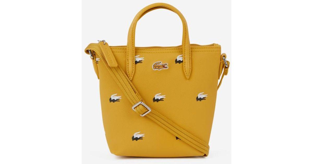 pas cher pour réduction e1d21 5db9b Mini sac cabas Peacoat Lacoste en coloris Yellow