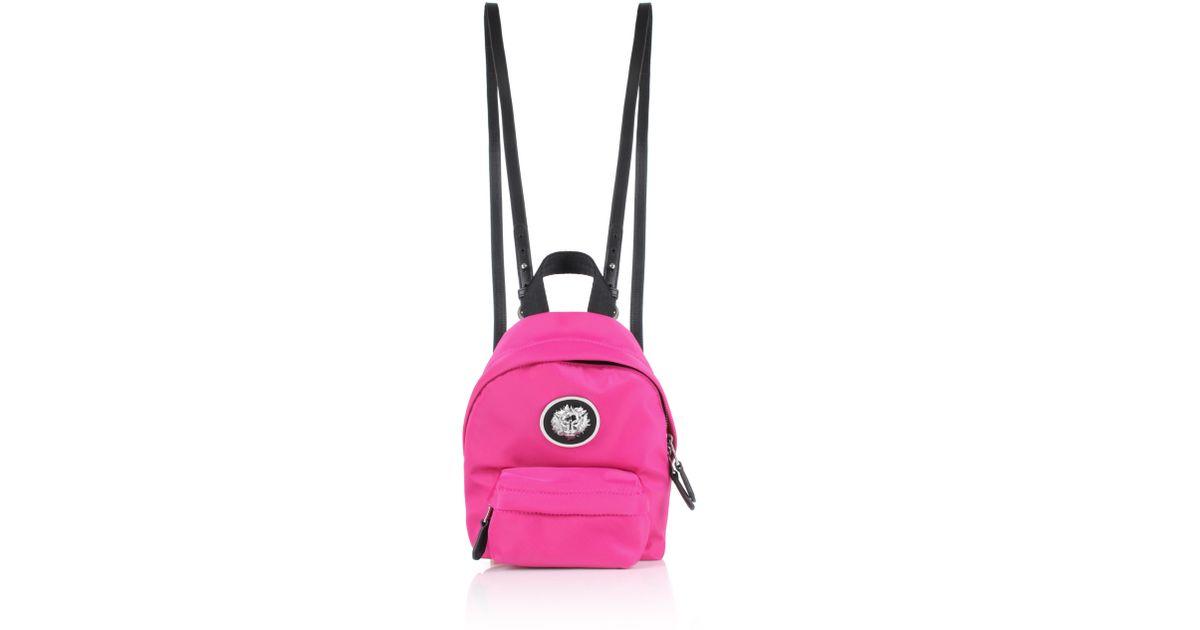90a59a294b77 Lyst - Versus Nylon Lion Head Mini Backpack Fuchsia nickel