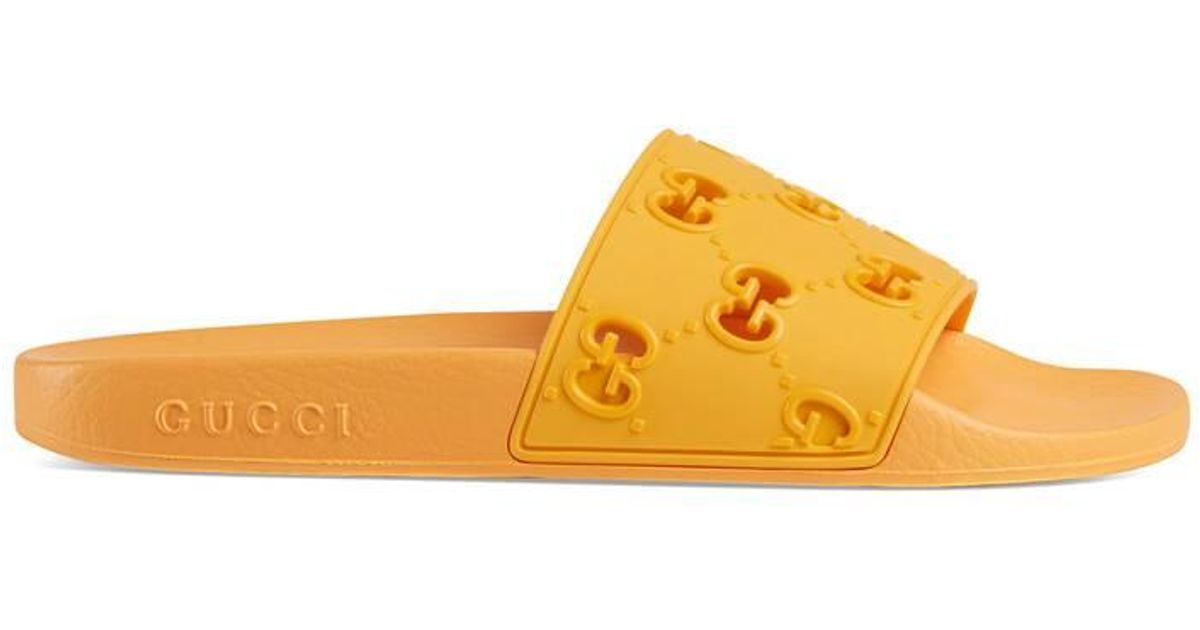 Gucci Rubber GG Slide Sandal in Yellow