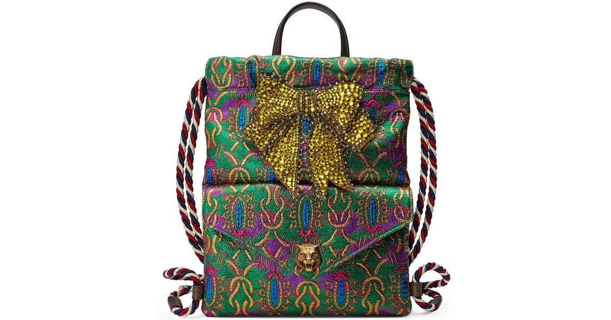 a513a9bf23a Lyst - Gucci Crystal Bow Brocade Drawstring Backpack