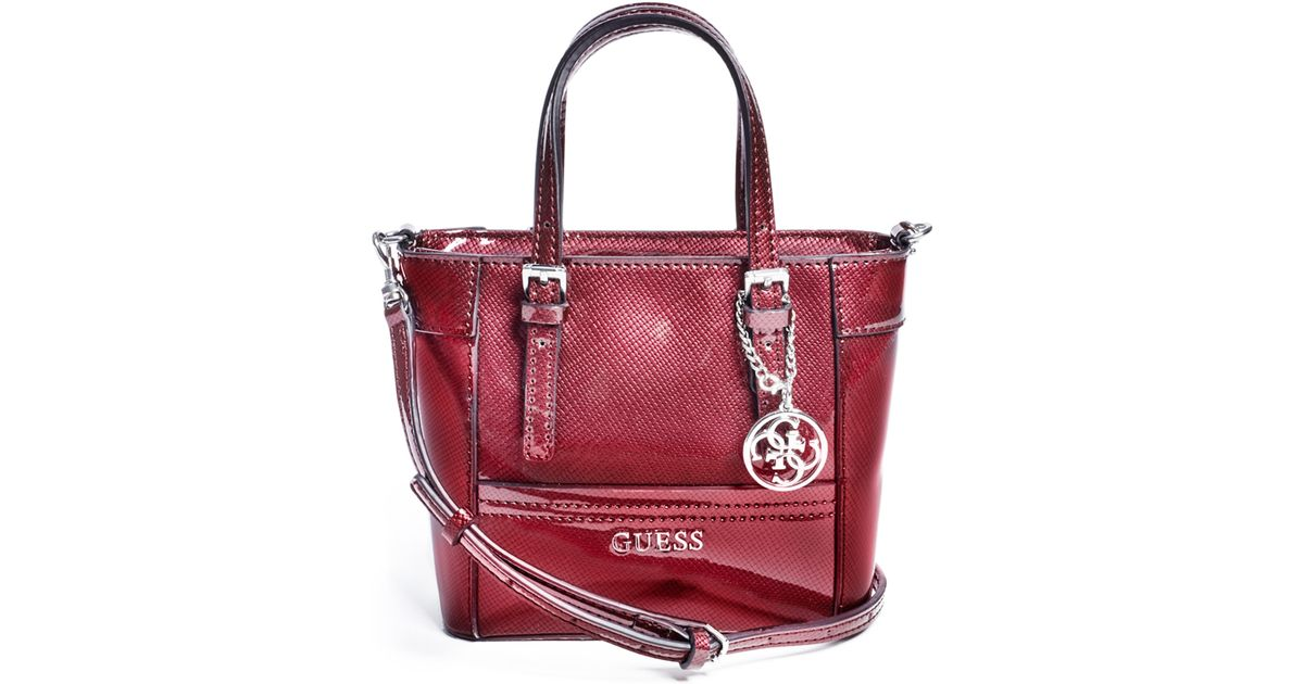 8a16acaba1 Lyst - Guess Delaney Patent Mini Tote