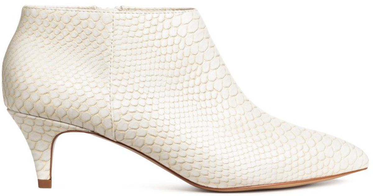 cda521feb39 H&M White Snakeskin-patterned Boots
