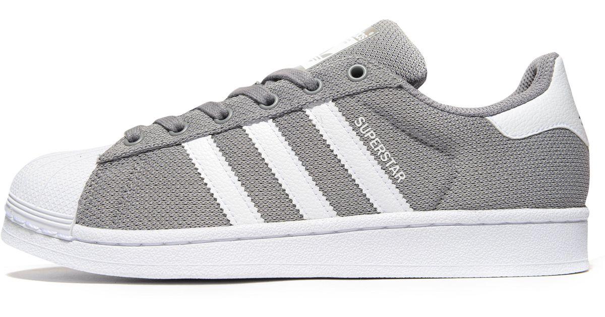 white and grey superstars