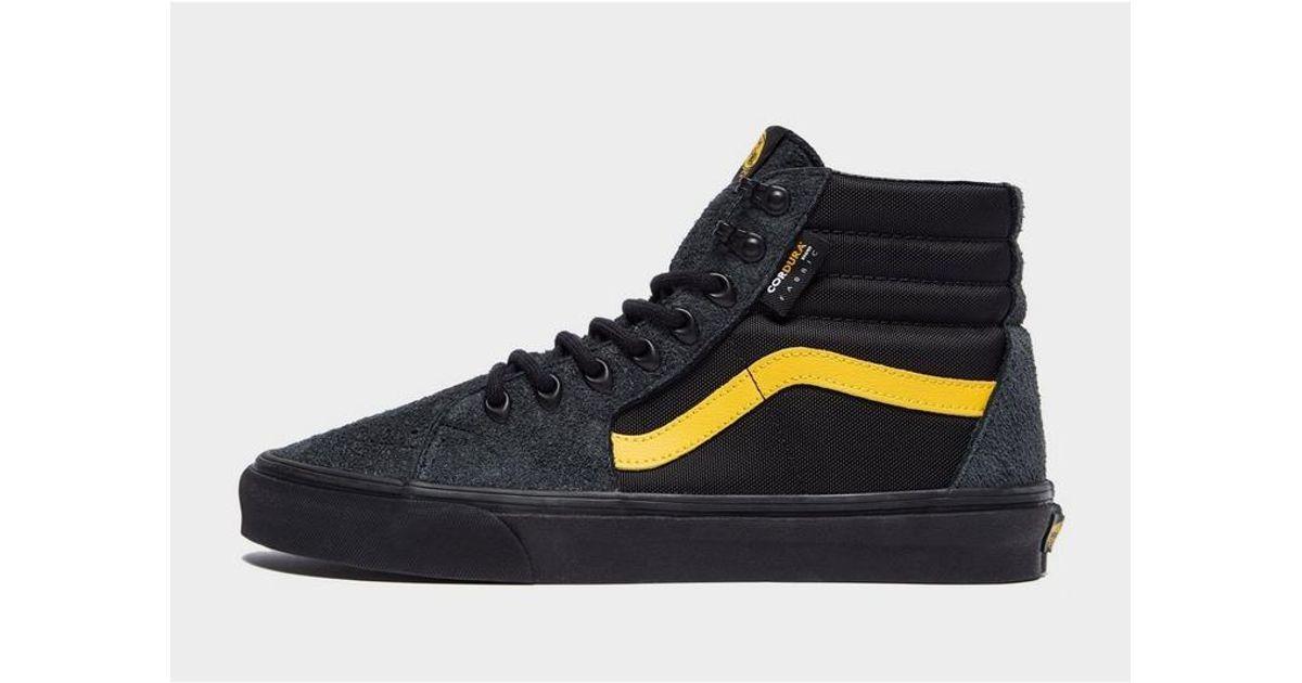 black and yellow low top vans