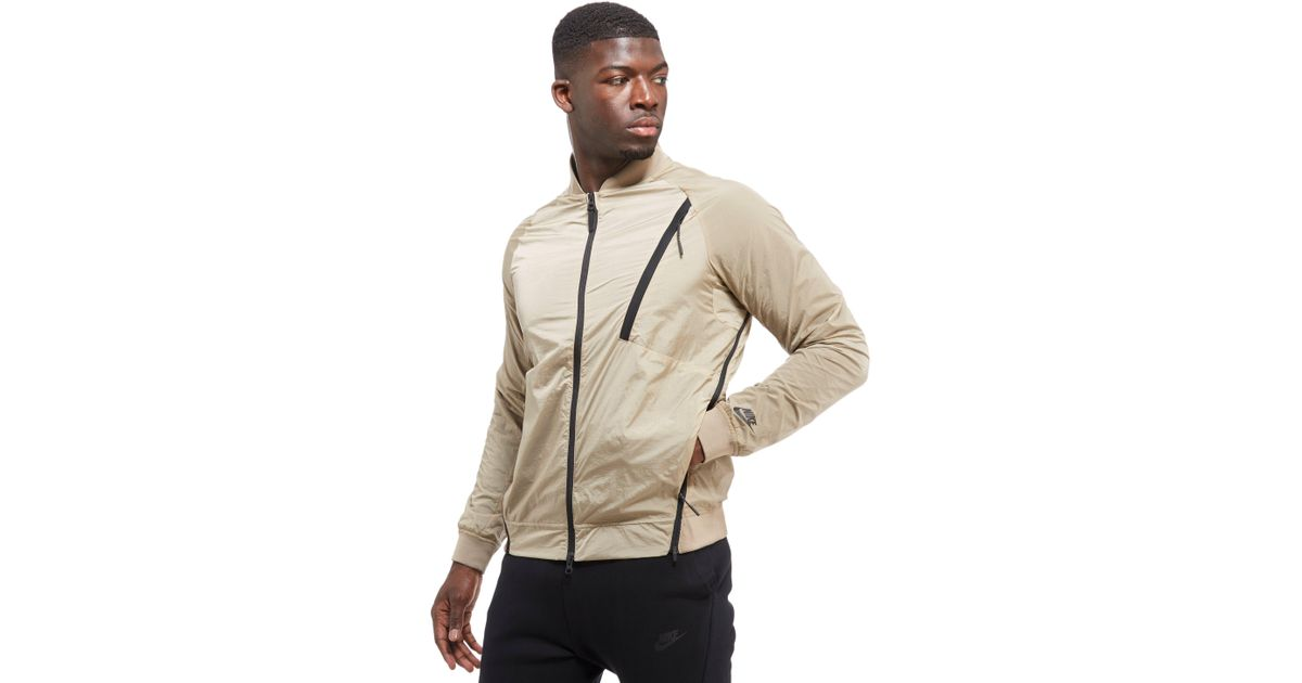 b98716f890f1 Lyst - Nike Tech Hypermesh Varsity Jacket in Natural for Men