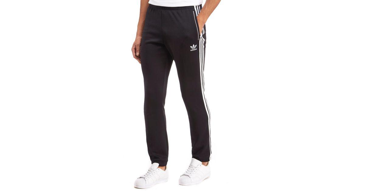 Adidas Originals Black 3 stripes Superstar Track Pants for men