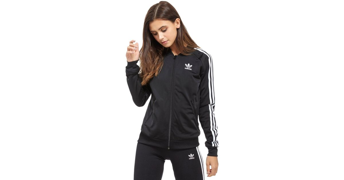08b7fdfaaf Lyst - adidas Originals Supergirl Track Top in Black