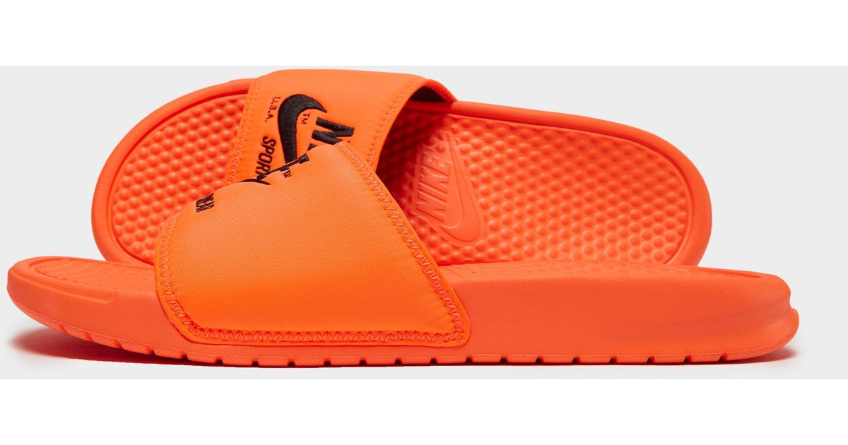f89a2bb5995d Lyst - Nike Sportswear Benassi Text Slides in Orange for Men