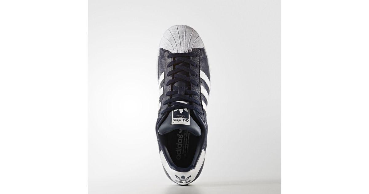 innovative design ecfdf 099e3 la fondation fondation fondation catalyseur adidas originaux superstar  chaussures en bleu pour les hommes b7d1c0