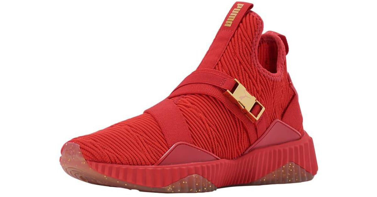 huge selection of 31b19 f43c8 PUMA Defy Varsity Mid Women s Sneakers in Red - Lyst