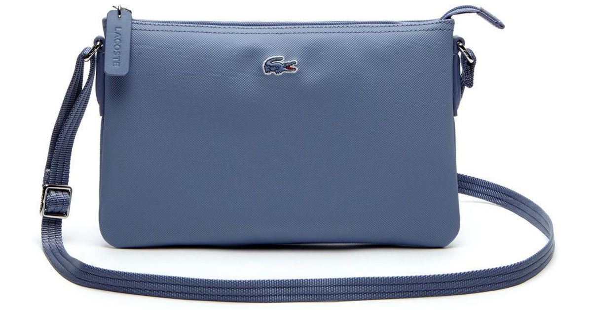 9ef25e6c2b9d34 Lyst - Lacoste L.12.12 Concept Flat Crossover Bag in Blue