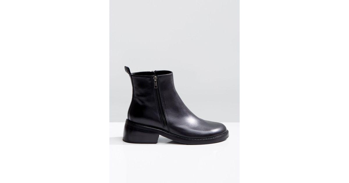 Women's Black Double Side Zipper Ankle Boots by Ann Demeulemeester