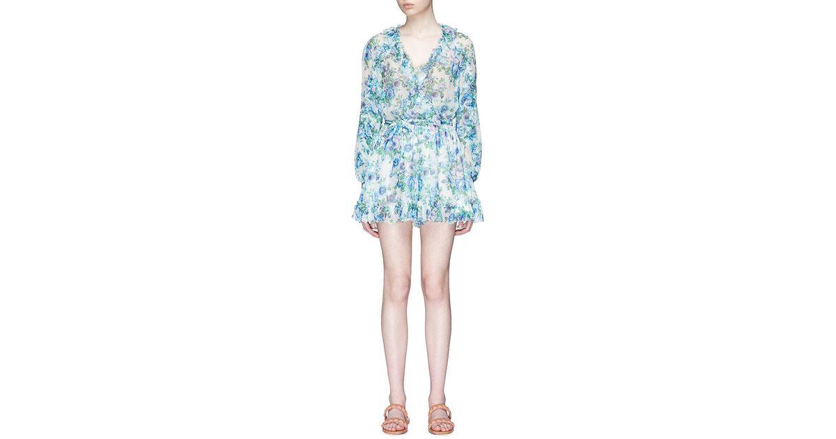 5bdc907729 Lyst - Zimmermann Whitewave Ruffle  Belted Floral Print Georgette Playsuit  in Blue