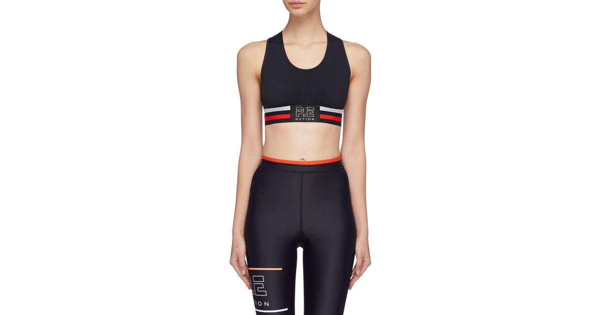 3498d492f4 P.E Nation  speedway  Stripe Cross Back Sports Bra in Black - Lyst