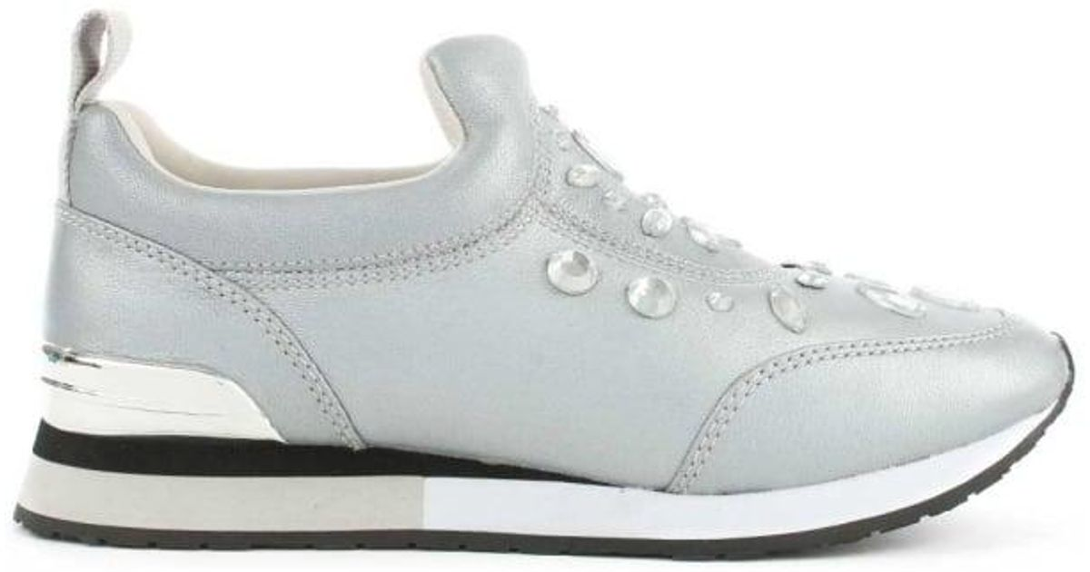 1e3a4cb0d37 Lyst - Tory Burch Laney Silver Leather Embellished Slip On Trainer in  Metallic