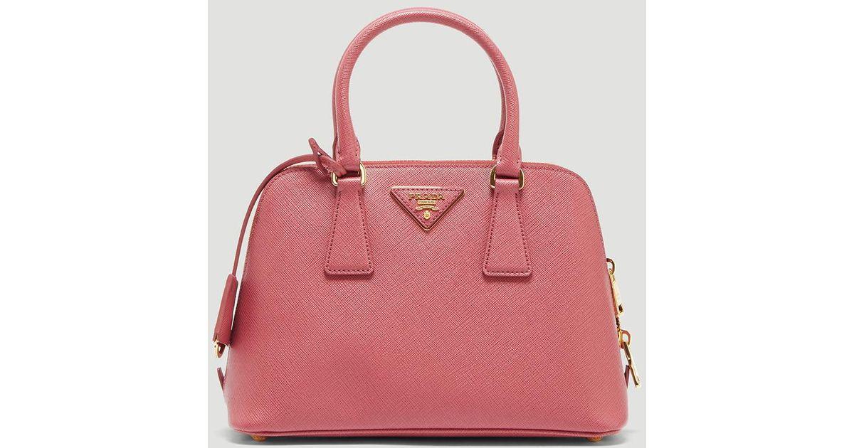 4b9709695886 Prada Round Saffiano Hand Bag In Pink in Pink - Lyst