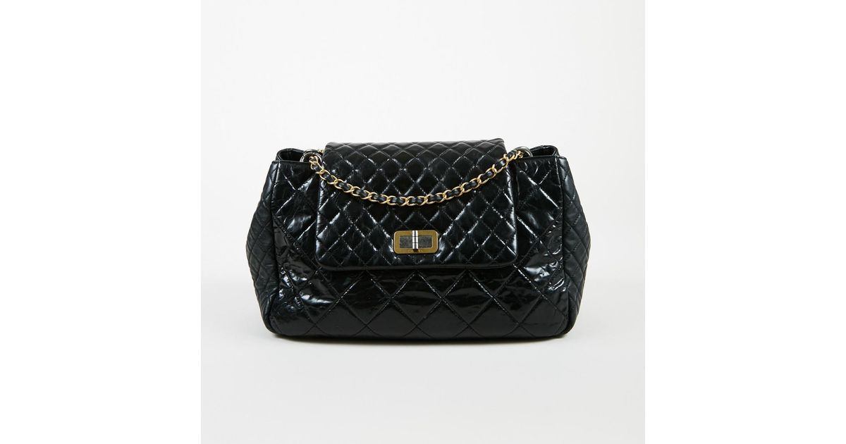 239e27707ca Chanel Fall 2011 Black Aged   Smooth Calfskin Quilted Reissue Accordion  Flap Bag in Black - Lyst