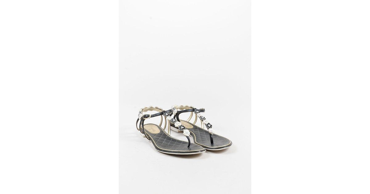 37f16a9ae Lyst - Chanel 2015 Black White Leather Camellia Flower Faux Pearl Thong  Sandals in White