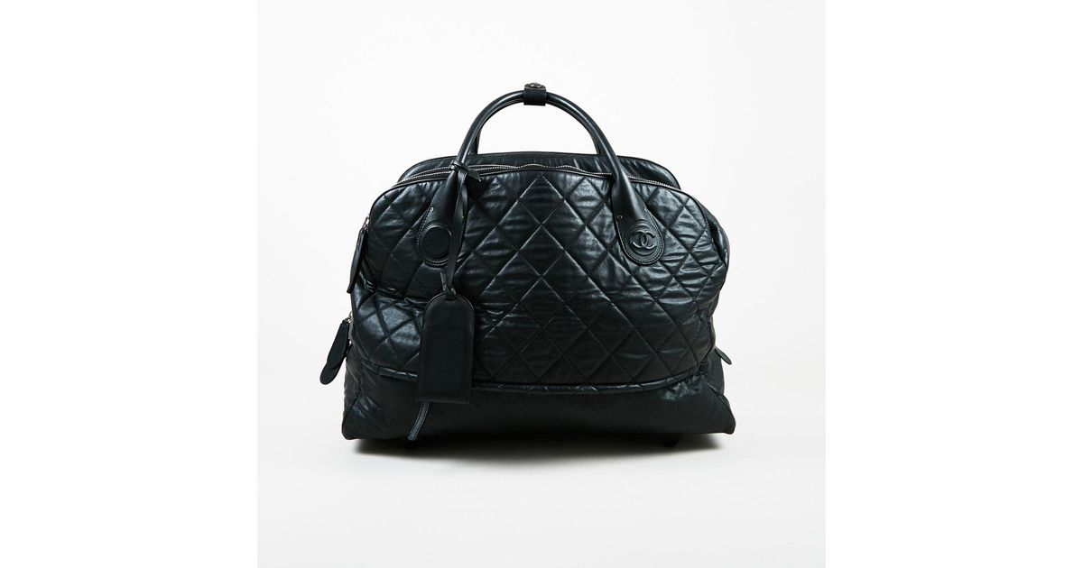 Chanel Black Quilted Multi Compartment Rolling Weekender Bag