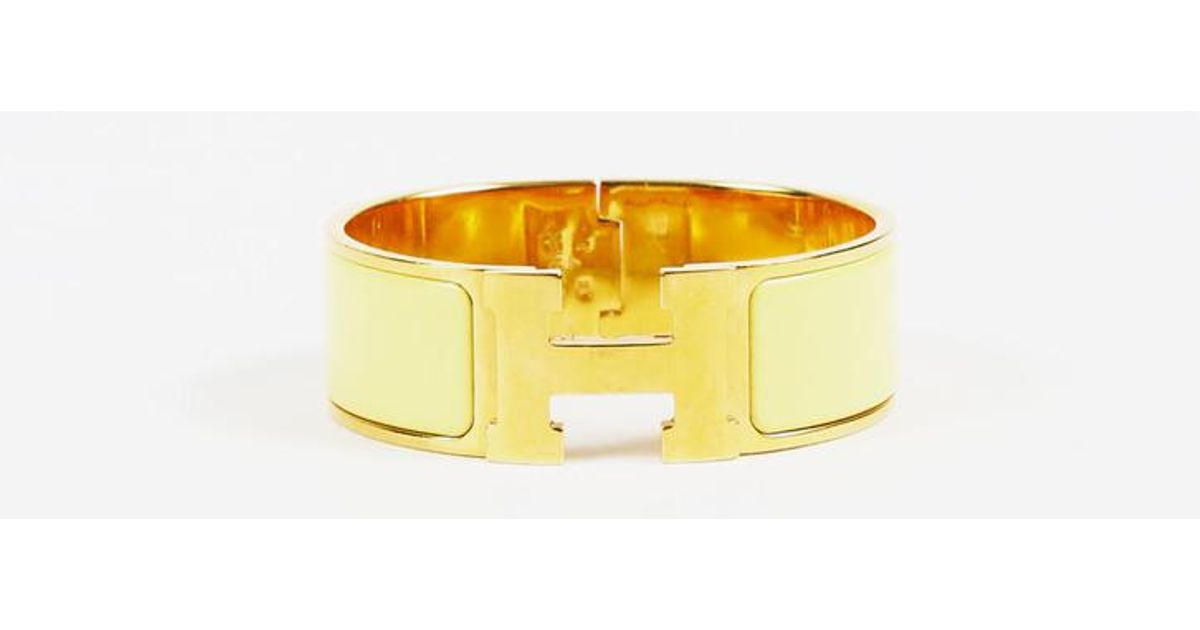 5fa8d8c52bcd44 Hermès Yellow Enamel Gold Plated Metal