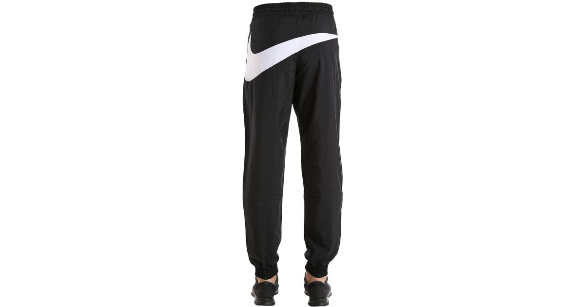 0300f3fbef Nike Black Vaporwave Swoosh Woven Track Pants for men