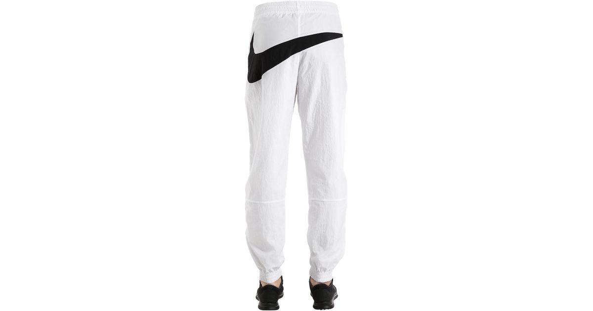 a486c02d2c4602 Nike Vaporwave Swoosh Woven Track Pants in White for Men - Lyst