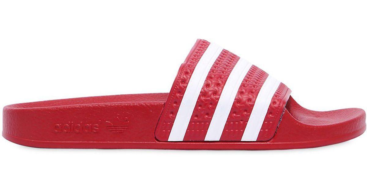 49b6c1311c14f adidas Originals Adilette Slides in Red - Lyst