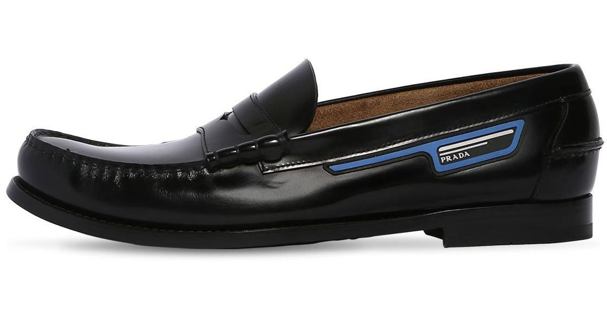 499161098a6 Lyst - Prada Leather Penny Loafers W  Logo Patch in Black for Men