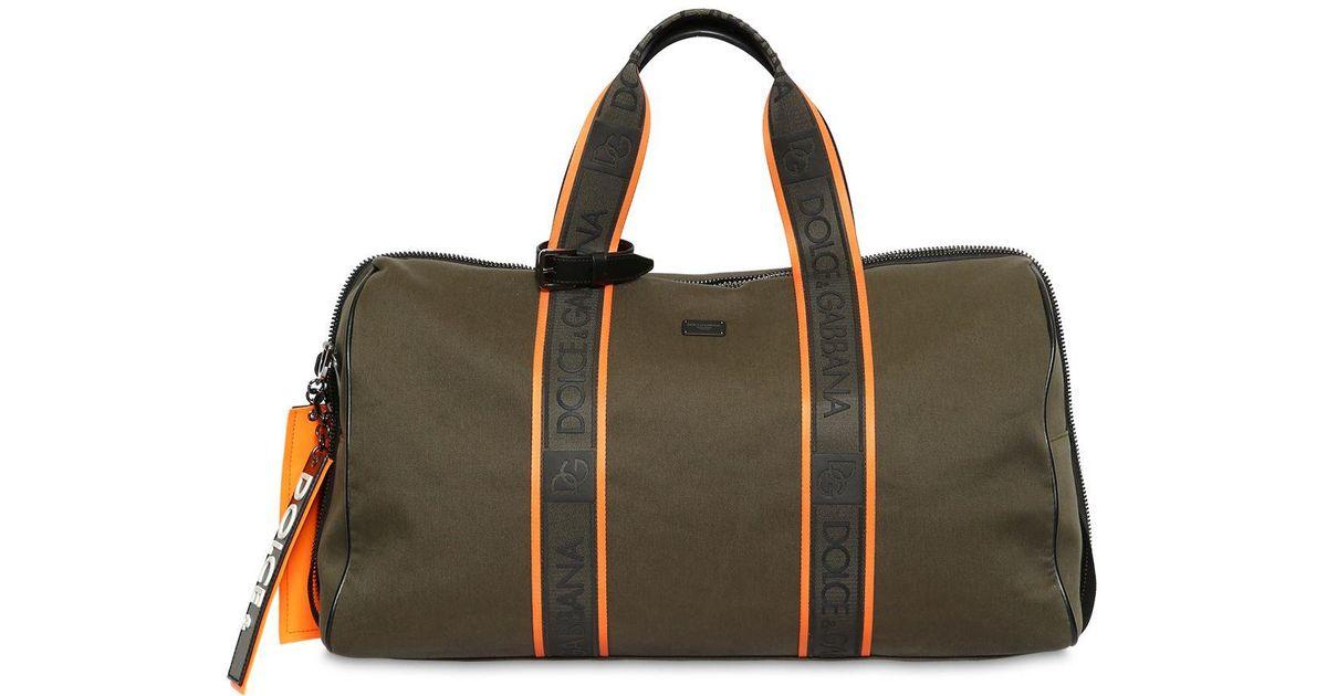 df80a9da95da Lyst - Dolce   Gabbana Logo Cotton Canvas Duffle Bag in Green for Men