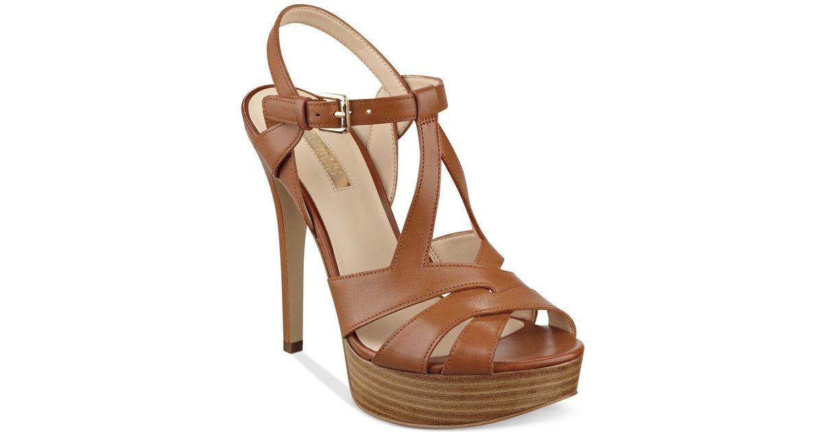 4bae37008cb Lyst - Guess Women s Kymma Strappy Platform Dress Sandals in Brown