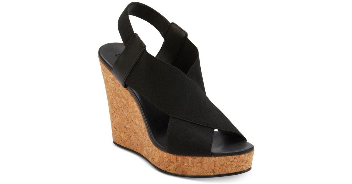 9c86da04499 Lyst - DKNY Jamara Wedge Sandals