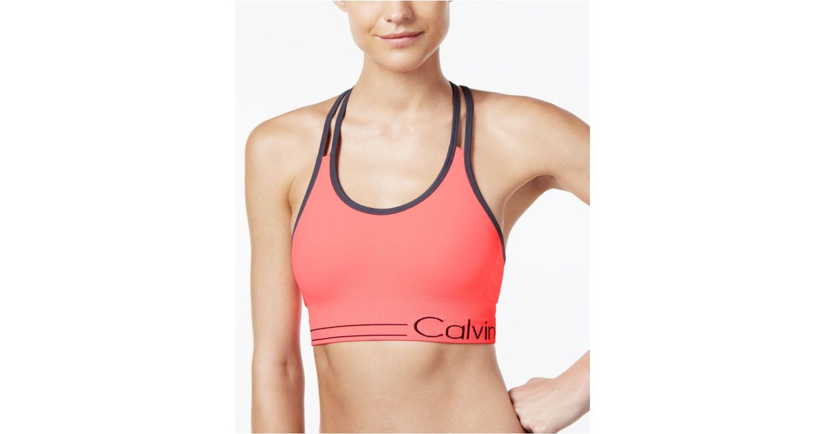 41d4cd1909 Lyst - Calvin Klein Performance Low-impact Strappy Sports Bra in Pink