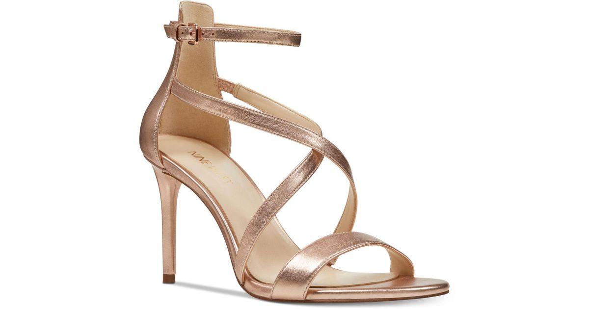 bc5ff007e55 Lyst - Nine West Retilthrpy Strappy Sandals in Metallic