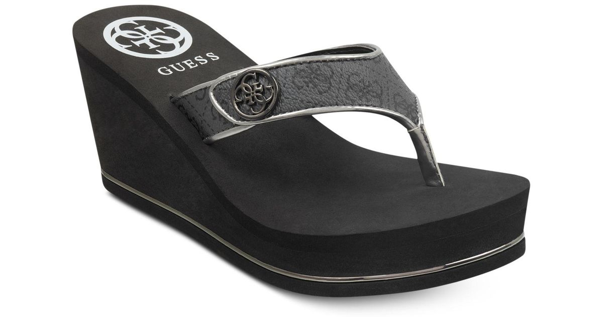 88a8d1b478 Guess Sarraly Eva Logo Wedge Sandals in Black - Lyst
