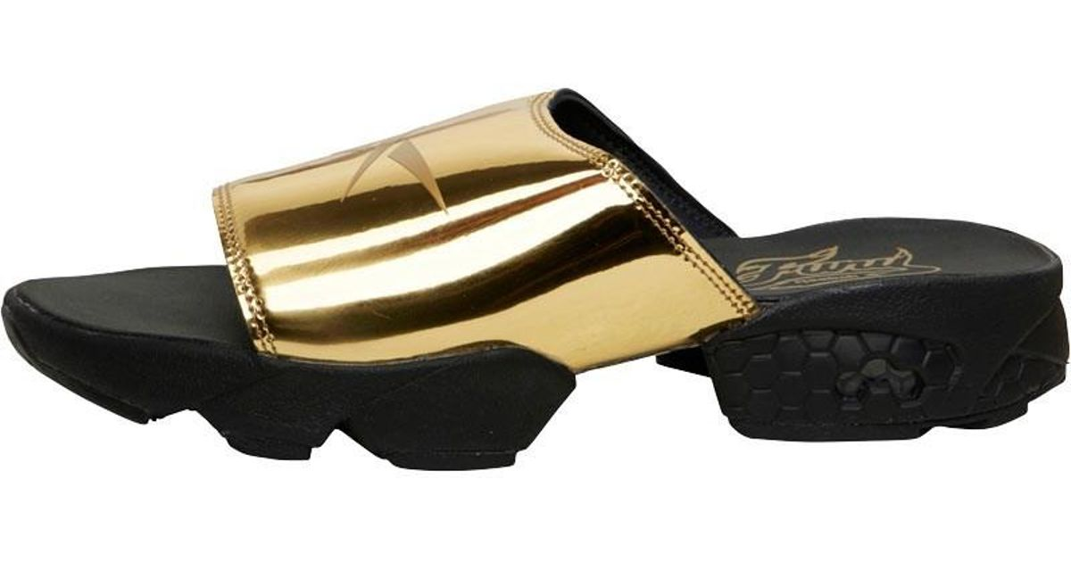 cb8078f03 Reebok Fury Slide Magic Hour Sandals Gold Metallic black white in Metallic  - Lyst