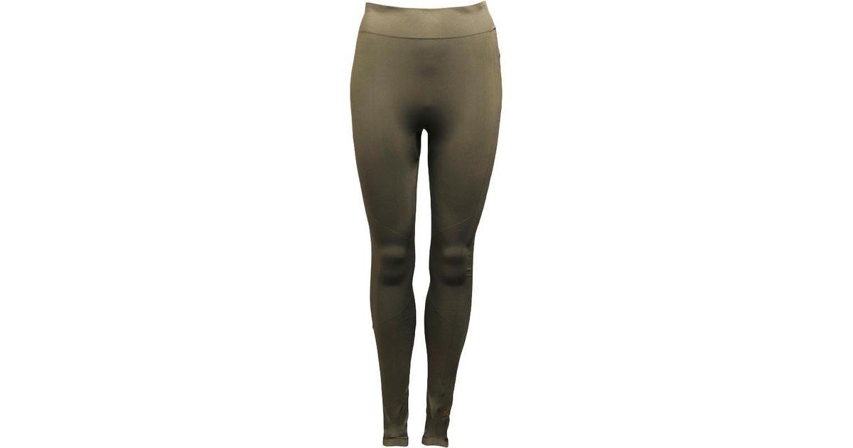 parhaiten rakastettu yksityiskohtaiset kuvat tarjouskoodit PUMA Green Evoknit Drycell Tight Leggings Olive Night