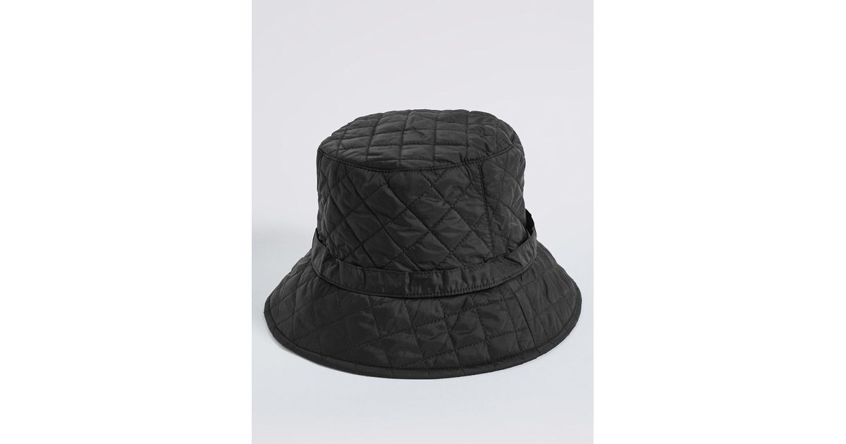 7481a4206d4 Marks   Spencer Quilted Popper Strap Winter Hat in Black - Lyst