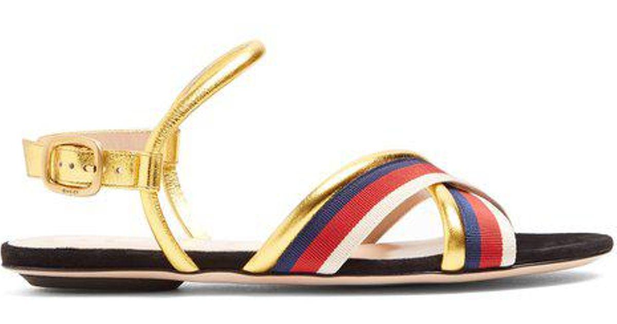 e886c758a6d81 Lyst - Gucci Sylvie Web-trimmed Leather Sandals