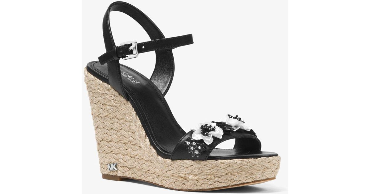 0733926571ed Lyst - Michael Kors Jill Floral Sequined Leather Wedge in Black