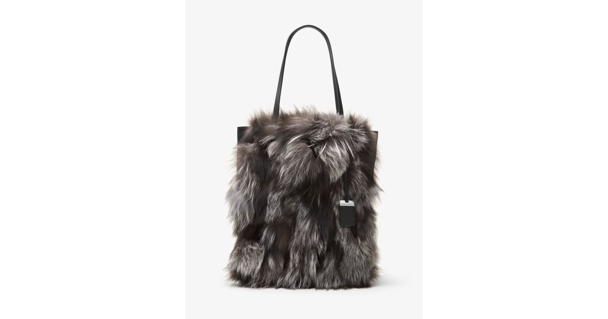 1d0f56c31aeb Michael Kors Eleanor Large Fox Fur And Leather Tote in Metallic - Lyst