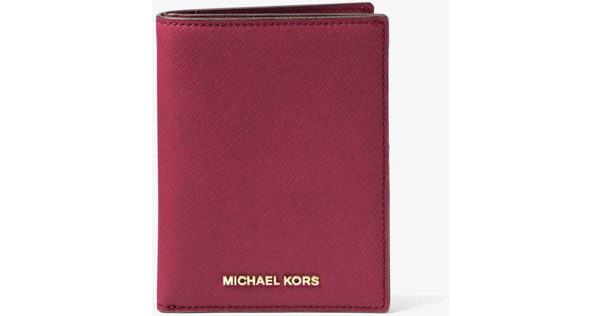 8abbbd6496db Michael Kors Saffiano Leather Passport Wallet - Lyst