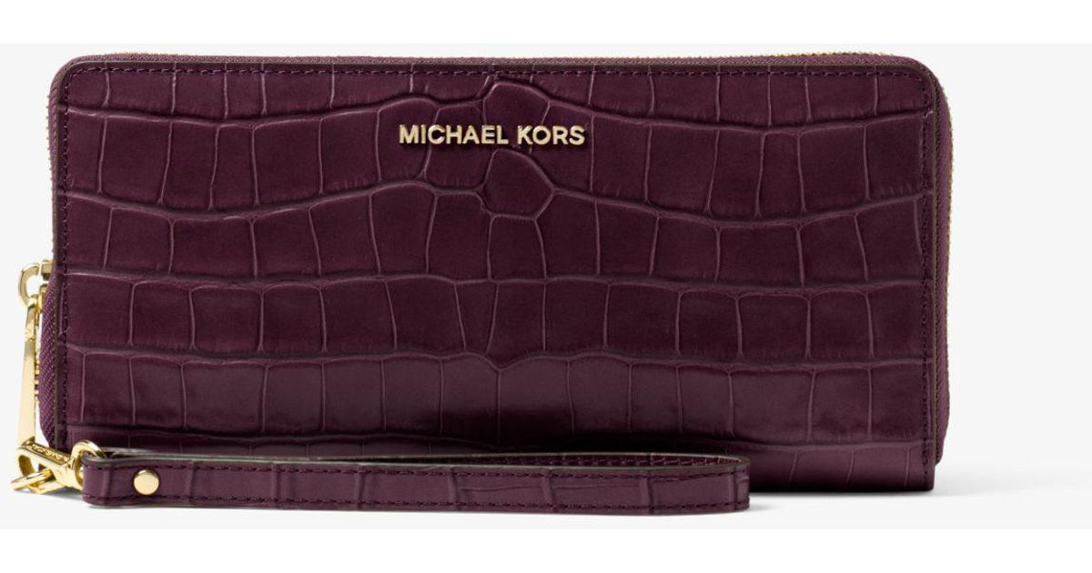 64378a7b0e3d Lyst - Michael Kors Jet Set Travel Embossed-leather Continental Wristlet in  Purple