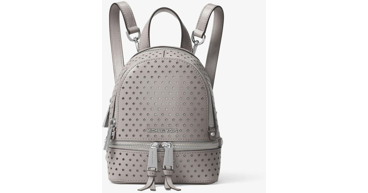 10e89a34a2d7 Lyst - Michael Kors Rhea Mini Perforated Leather Backpack in Gray