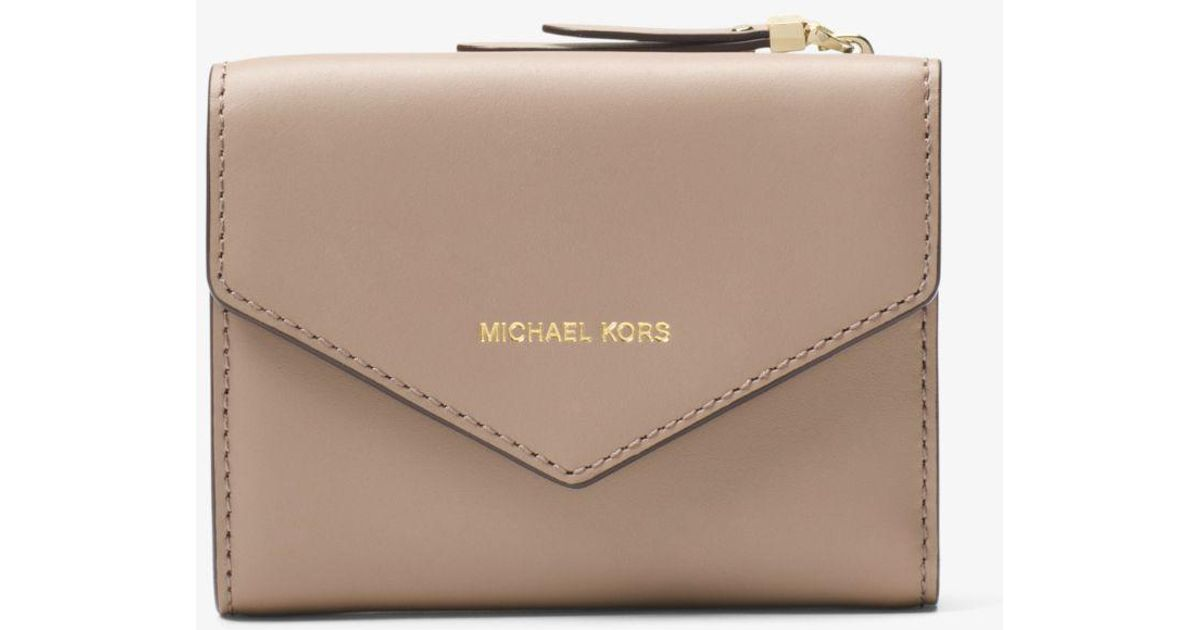 0073f2bfd131 ... italy lyst michael kors jet set small leather envelope wallet in brown  25e7c a77df
