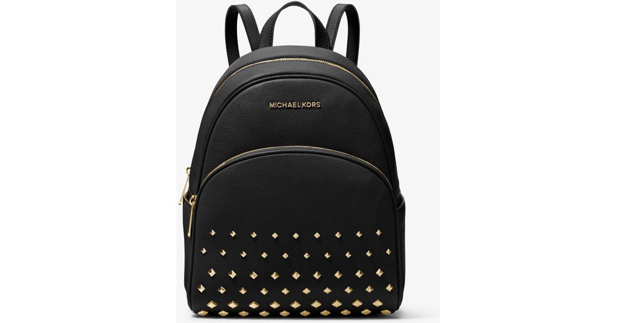 Lyst - Michael Kors Abbey Medium Studded Pebbled Leather Backpack in Black c3b2b38cd0f10