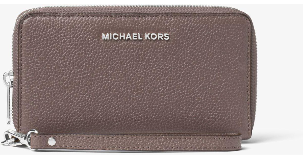 fe7cf96feaec88 Michael Kors Large Leather Smartphone Wristlet - Lyst