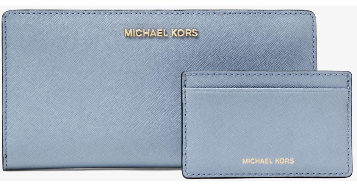 bd54c9cf6306 Lyst - Michael Kors Large Saffiano Leather Slim Wallet in Blue