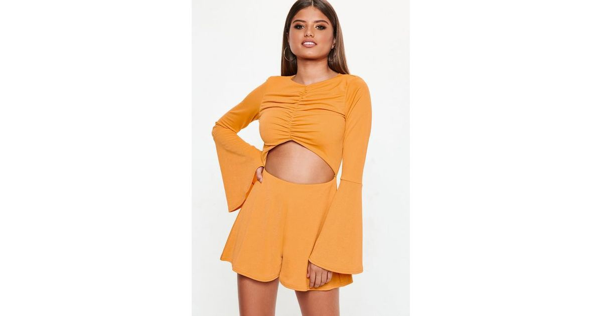 b34d69bd409 Missguided Mustard Cut Out Long Sleeve Romper in Orange - Lyst