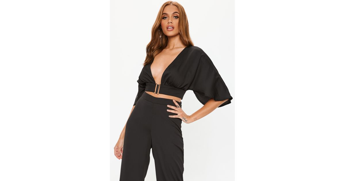 3895e087a0c Lyst - Missguided Black Clasp Detail Batwing Satin Crop Top in Black
